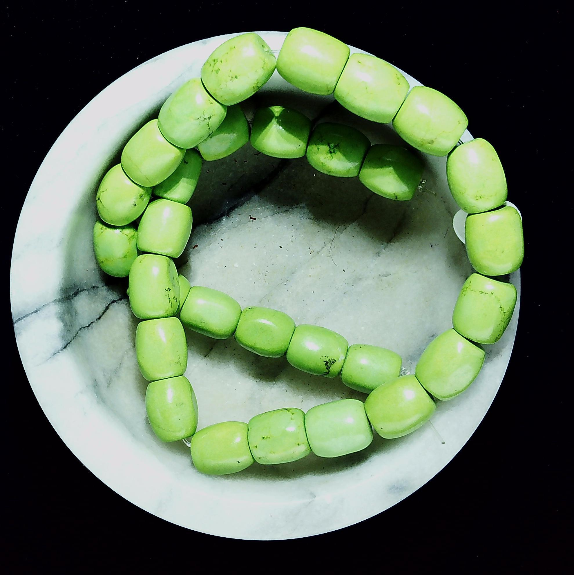 Apple green magnesite 14mm barrel beads  16 inch strand