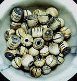 Bone barrel and round bead lot