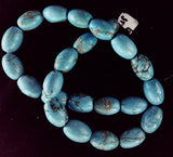 Powder turquoise blue oval beads  1 strand