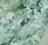 Pale green glass medium chip beads 33 inch strand
