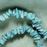 Blue powdered turquoise small chips  15 inch strand