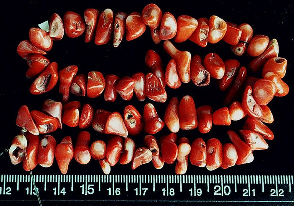 Salmon red coral nugget beads (15 inch strand)