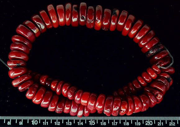 Bright red coral graduated irregular wheel beads (18 inch strand)