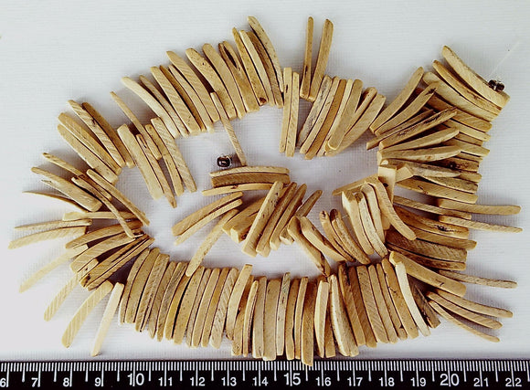 Light brown Coco wood top/center drilled stick beads 4mm x to 25mm (16 inch strand)