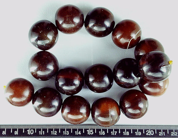 Brown horn  25mm polished round beads (15 inch strand)