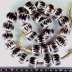 Dark brown and cream pattern bone 16mm x 20mm beads w/wood center (20 inches)