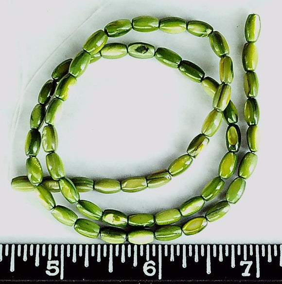 Green Mother of Pearl 7mm x 3mm stick beads  (15 inch strand)