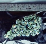 Peridot green AB Swarovski crystal faceted round  30 bead lot