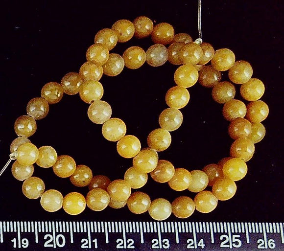 Yellow marble 6mm polished round beads (16 inch strand)