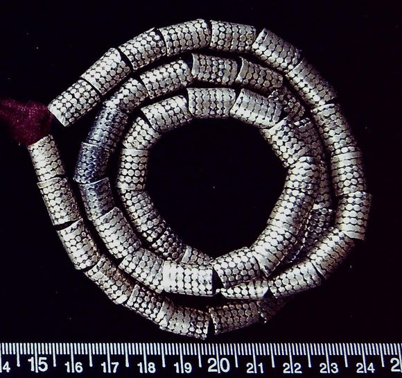 Silver metal patterned 14mm x 8mm round tube beads (23 inch strand) large hole