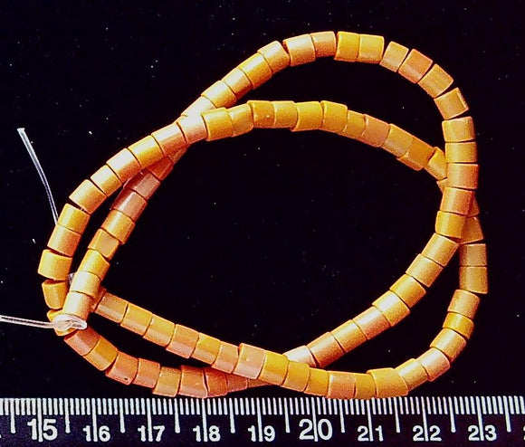 Orange glass wheel bead (4mm x 5mm) (16 inch strand)