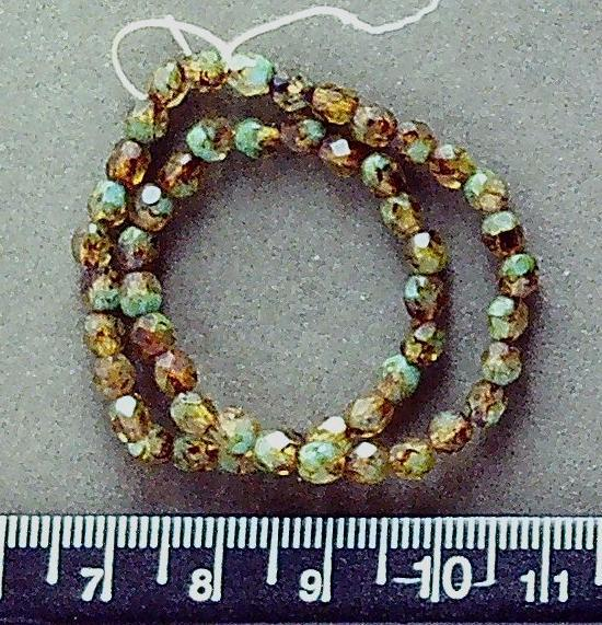Firepolished golden/brown with green faceted oval glass  beads (4mm x 3mm) (8 inch strand). Very attractive color combo!
