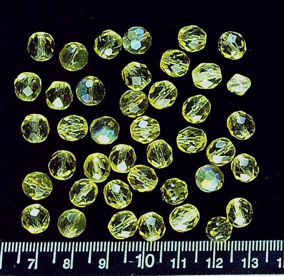 Yellow glass facteted round beads (most 8mm, includes four AB) (41 beads)