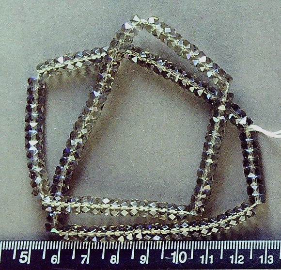 Olive/brown glass faceted 3mm x6mm wheel beads with AB coat on end cuts (16 inch strand)