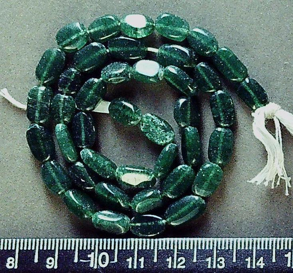 Dark green stone   10mm x 5mm flat irregular oval beads (13 inch strand)
