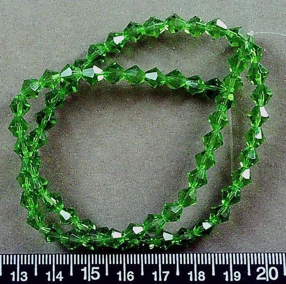 Green crystal glass 6mm bicone beads (16 inch strand)