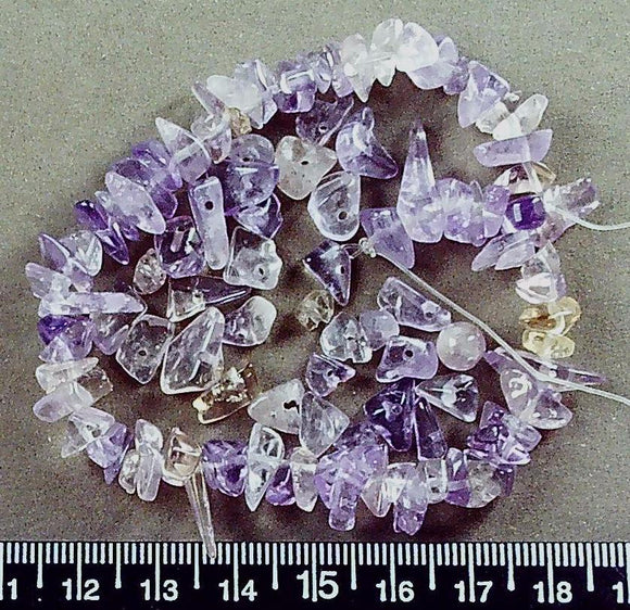 Purple amethyst  medium chip beads (about 10 inches, part loose)