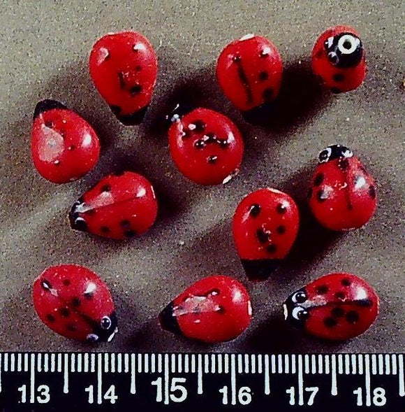 Red with black ladybug lampwork glass beads (12mm x 10mm) 11 beads