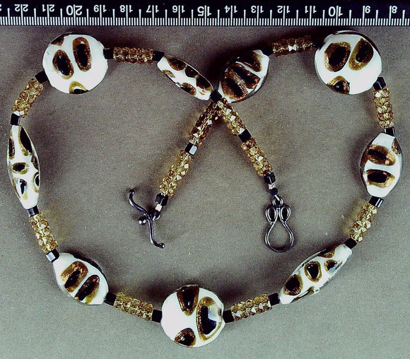 White/black/gold glass necklace with sterling silver toggle clasp (19 inches)