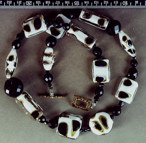 White/black/gold glass necklace with brass toggle clasp (22 inches)