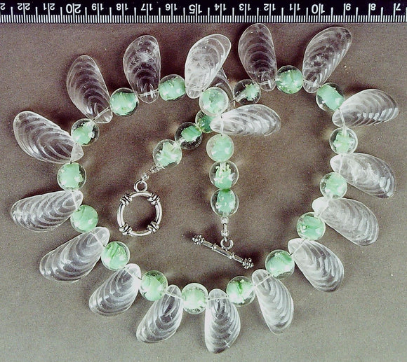 Colorless and green glass necklace with sterling toggle clasp (16 inches)