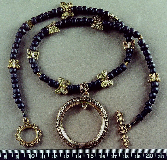 Black and brass 19 inch necklace with 45mm circle pendant and toggle clasp