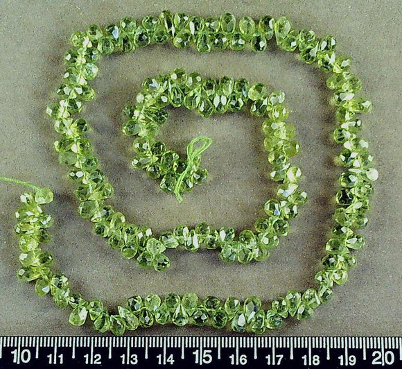 Pale green peridot briolette beads (4mm x 5mm) (18 inch strand)