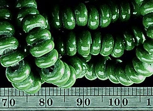 Green glass 2mm x 6mm beads 23 inch strand