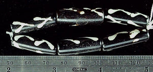 Black with white pattern 25mm x 10mm tube beads 5 inch strand