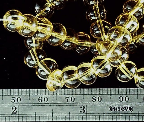Yellow color glass 6mm x 9mm rondelle beads 15 inch strand