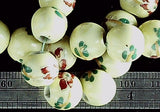 Pale yellow-green glass with green and red flowers 11mm round beads 16 inch strand