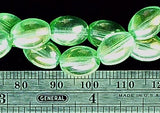 Medium green glass AB 10mm oval beads  16 inch strand