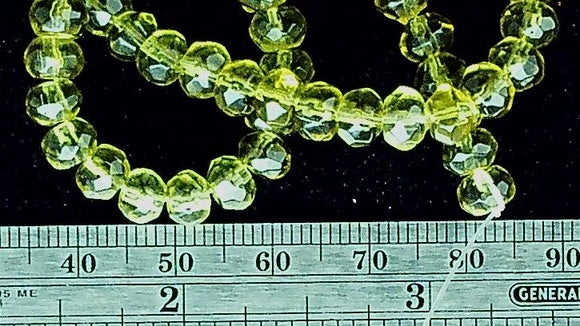 Light olive green glass 4mm x 5mm faceted rondelle beads 12.5 inch strand