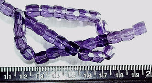 Purple glass 8mm faceted barrel beads  13 inch strand