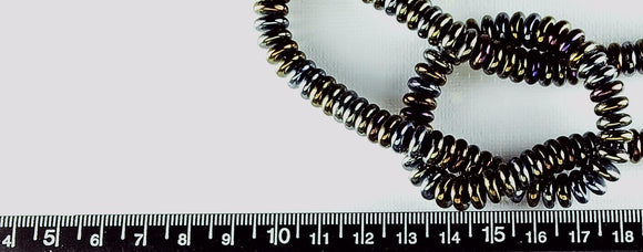 Black with bronze highlights glass 2mm x 8mm disk beads  16 inch strand