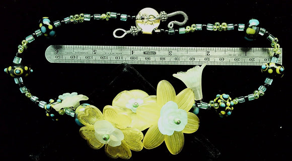 Yellow flowers vinyl and blue/green glass necklace   (15 in) 1