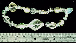 Funky multi bead clear/pale green bracelet on stretch cord