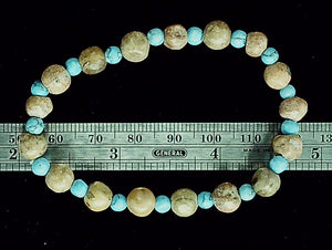 Tan stone and blue mixed bead bracelet on stretch cord