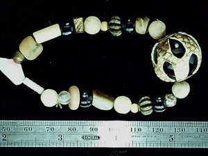 Tan and black mixed bead bracelet on stretch cord