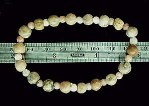 Sand colored mixed bead bracelet on stretch cord