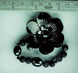 Funky black metal flower multi bead bracelet on stretch cord