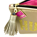 pink and gold clutch bag hustlin