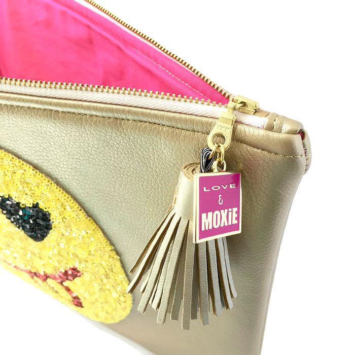 pink and gold emoji clutch