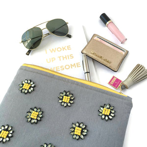 yellow and gray flower clutch