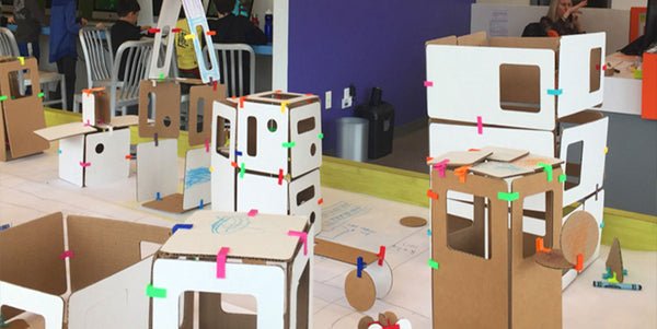 cardboard construction creating a city with urban planning curriculum