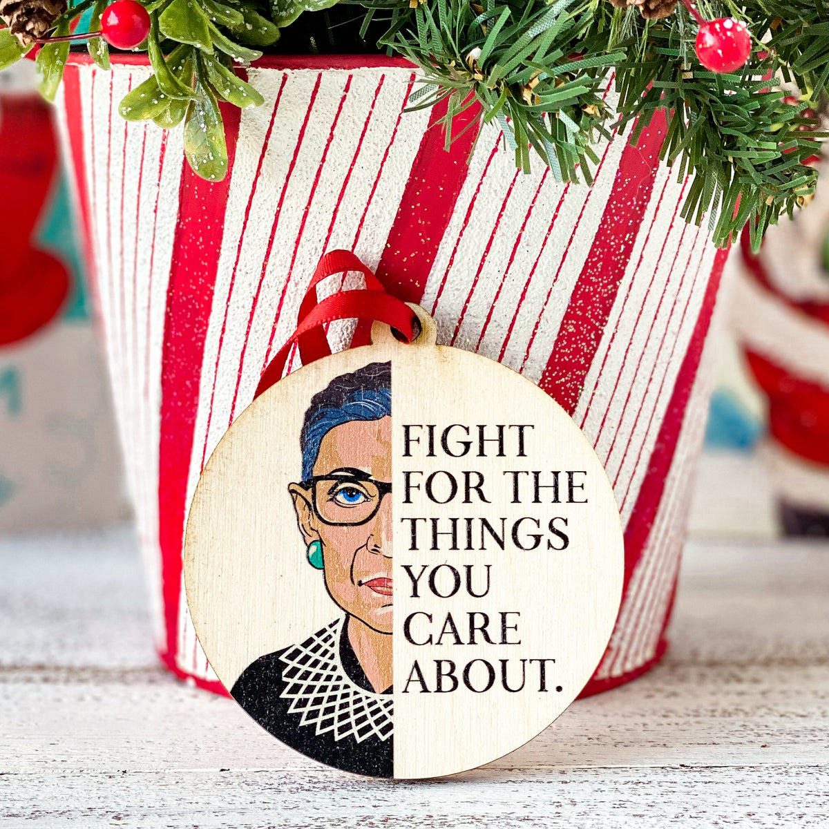 round ornament saying Fight For The Things You Care About and half of Ruth Bader Ginsburg's Face