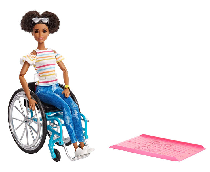 FANS ARE CELEBRATING THE AFRICAN AMERICAN BARBIE WHO USES A WHEELCHAIR