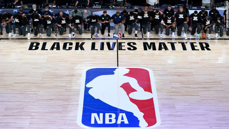 NBA players and coaches kneel during national anthem as season restarts