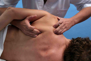 deep tissue massage of shoulder