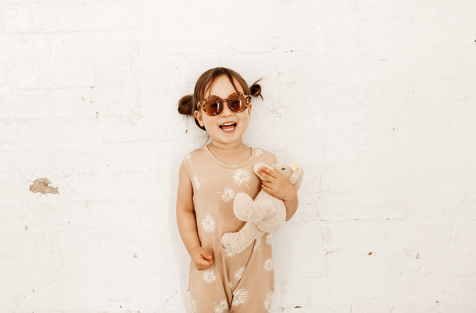 Honey  baby playsuit cream palm fronds. Organic cotton and bamboo